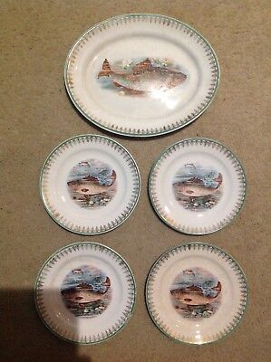 Edward M. Knowles platter and plates with fish design