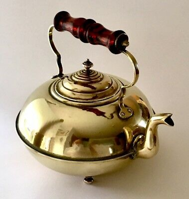 Edwardian Brass Tea Kettle With Amber Glass Handle And Four Small Round Feet.