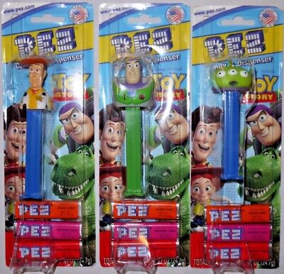 BNWT Lot of 3 PEZ DISNEY TOY STORE Pixar Buzz Lightyear Woody Alien