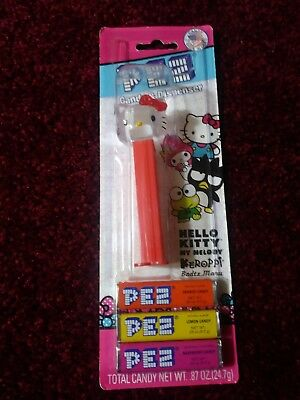Hello Kitty Clear Pez  Dispenser  Red Bow   With pez candy ..in pack. new