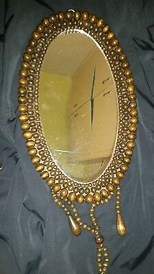 Antique beaded wall mirror