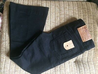 New black flared girls Next jeans, Size 7 years