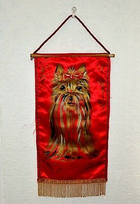 Gold painted red satin Wall Hanging of a Yorkshire Terrier by Sylvia Smith 1979