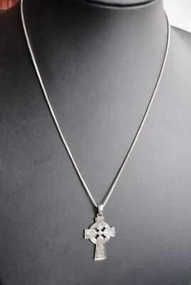 Ancient silver cross amulet.