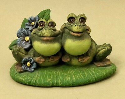 Frog Couple Sitting on a Lily Pad Surounded by Flowers - by Artist Pete Apsit