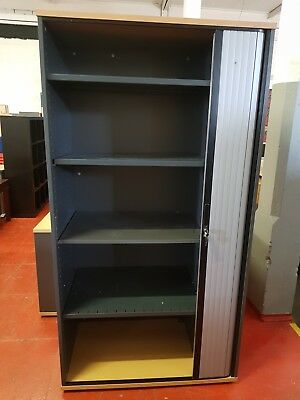 Office cupboards heavy duty sliding doors with key,grey in colour 4 shelves .