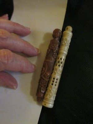 Early 1800's sailor-carved NOT PLASTIC screw-on holders tops of some type?