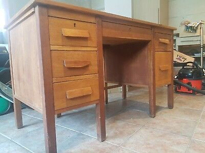 Vintage teacher's-style wooden desk with drawers, believed to be from 1950s
