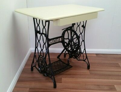Singer Cast Iron Treadle Base Sewing Machine Table with Centre Drawer.