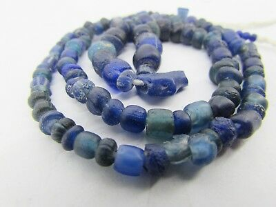Ancient 121 Roman Glass rare tiny beads in blue lapis colors from Afghanistan.