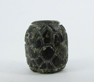 Ancient etched draw flowers bead of black stone from Pakistan.