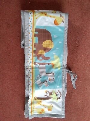 Set of cot bumpers with jungle animal pictures.