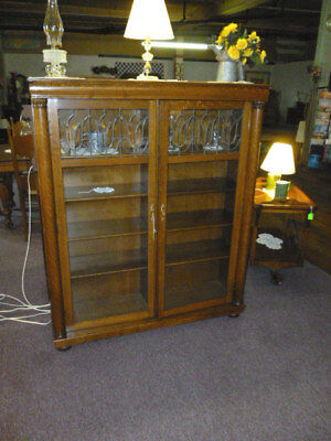 Antique Oak Bookcase Double Door Leaded beveled glass Larkin china curio 48""