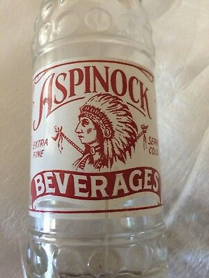 Aspinock Beverages,great graphics,dimpled MT Soda Bottle 12 oz.1942 ACL Indian