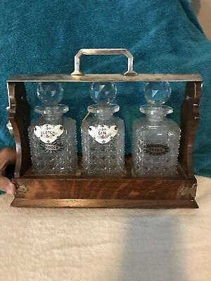 Antique English Oak and Metal Tantalus Set Crystal Decanters