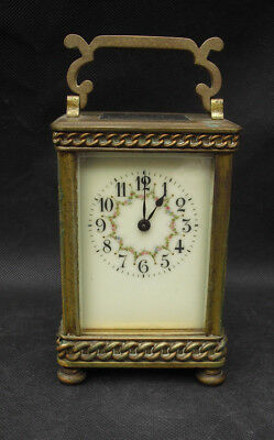 Antique carriage clock with pretty floral enamel faceby R&Co Paris French clock