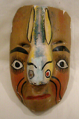 Vintage/Antique Wooden mask. A human face with rabbit nose