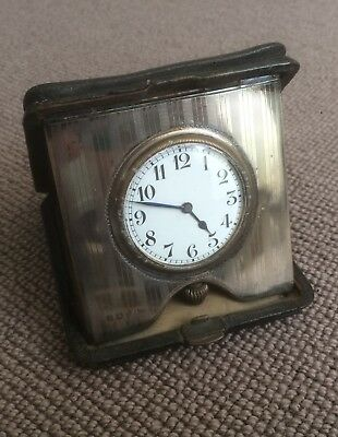 Antique travel clock with leather case 1914. Made by H & A hallmarked silver
