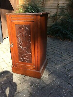 Victorian mahogany cupboard with carved front panel