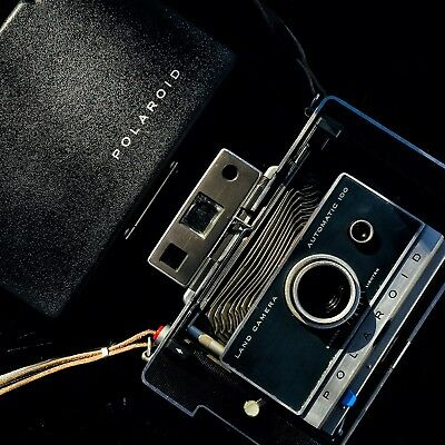 A Vintage Polaroid Automatic 100 Instant Camera In Nice Condition +Fitted Case.