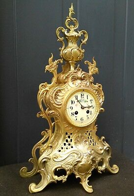 Antique French gilded bronze mantle clock Louis XV style, rococo