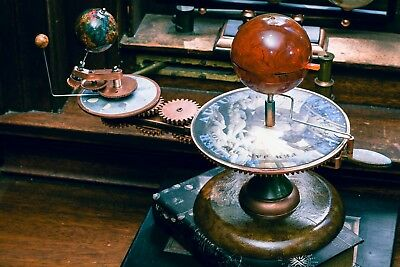 Artist enhanced to look antique tellurium planetarium orrery solar system model