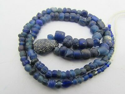 Ancient 122 Roman Glass rare beads of string in lapis colors from Afghanistan.