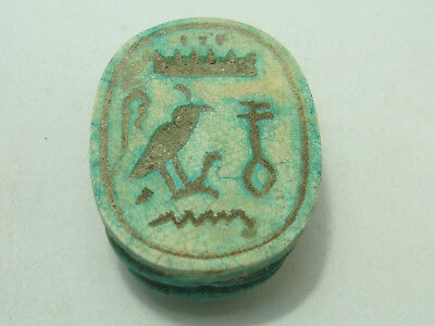 Egyptian  Scarab with hieroglyph inscription on the base (Faience)