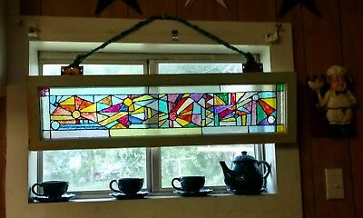 Faux Stained Glass. Hand Painted on a circa1940 antique transom window.