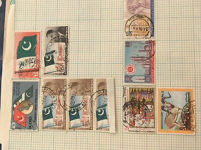 Oman & Pakistan mint and used stamps on album pages