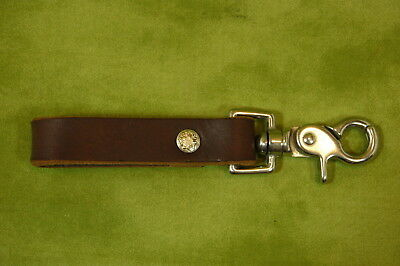 Handcrafted Leather belt loop with heavy chrome trigger-snap.