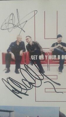 """U2 Get On Your Boots 7"""" Signed By The Edge And Adam Clayton Brussels 2010"""