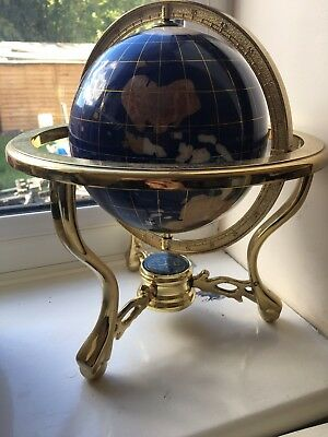 World Globe, on yellow metal stand, with compass. Semi precious gem stones