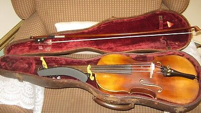 old vintage violin with lion head and antic case