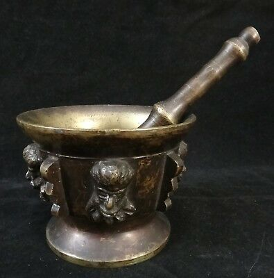 Antique European bronze mortar & pestle with masks on the sides.18th/19th c.