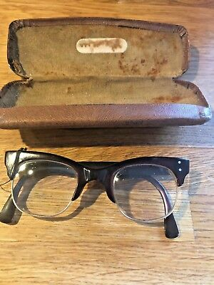 A pair of Vintage ladies spectacles in original tan case - cat eye part rimless
