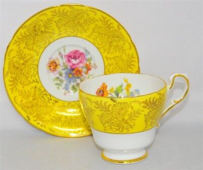 Paragon Yellow Band, Floral Filgree Gold Trim Teacup & Saucer