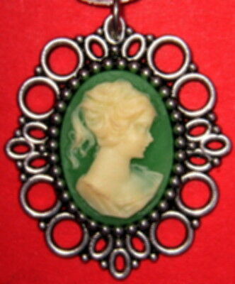 Silver Plated Pendant With A Victorian Bride  Cameo And A Green Colored Backgrou