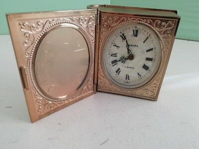 Vintage alarm clock in decorative 'book' effect case.  Fully working