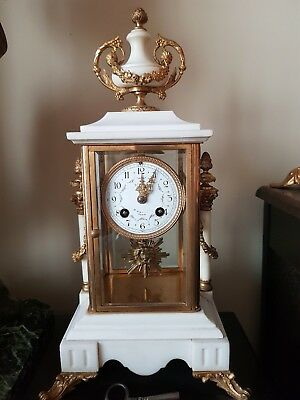 19th Century French Marble and Ormolu Four Glass Mantel Clock.