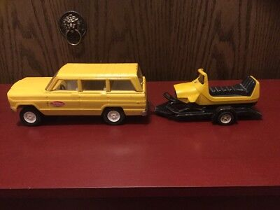 Vintage Tonka Jeep Wagoneer With Snowmobile And Trailer Yellow/Black 1960's.