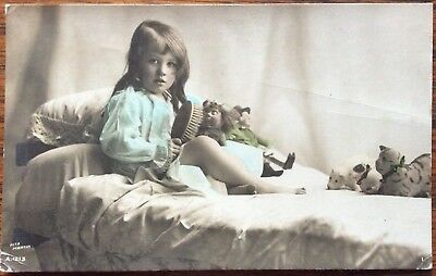 Antique Rppc Young Girl Brushing Dolls Her On Her Bed Other Soft Toys Looking On