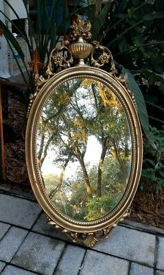 Vintage Neo-classical gold oval wall mirror urn crest Hollywood Regency
