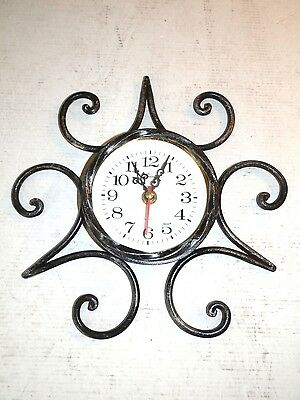 Clock by wall with movement quartz wrought iron with decoration iron