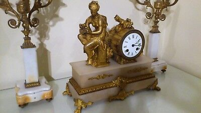 A 19th Century French Gilt and White Stone Figural Mantel Clock.