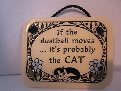 If the dustball moves..it's probably the CAT Trinity Pottery Wall Plaque USA NEW