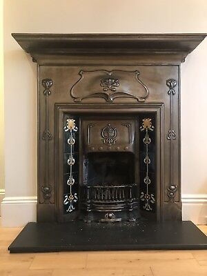 Cast Iron tiled combination fireplace In A Macintosh Style .