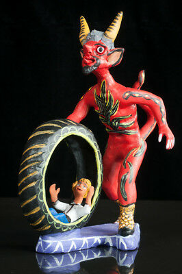 OCUMICHO CLAY FIGURE devil with wheel and kid by purepecha indigenous people