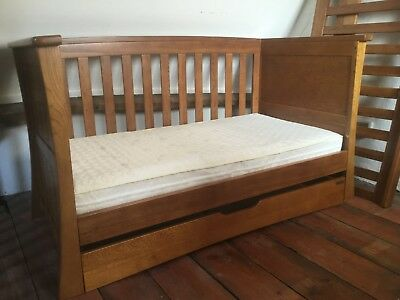 Beautiful Mamas and Papas Ocean Cot Bed with draw in Solid Golden Oak