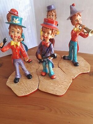 Antique figures, band of 5 that fit to gether to make stage
